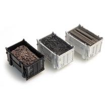 Containerfyld: Kul, Bjælker, Byggeaffald