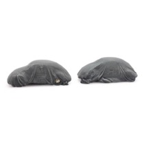 Cargo: Two VW Beetles with cover
