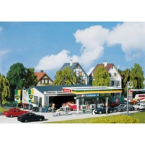 Petrol station with service bay