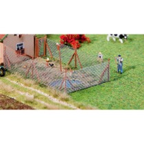 Wire mesh fence with wood poles