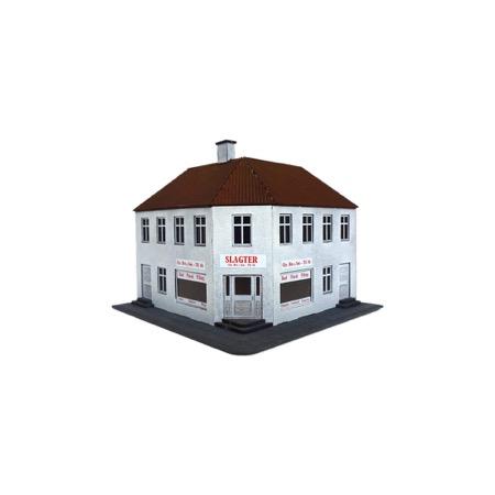 Hjørnebygning pudset med butik