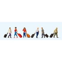 Gående rejsende med kufferter