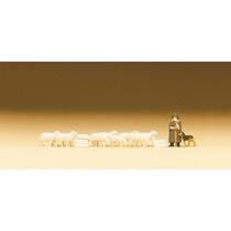 Fårehyrde med får og hund